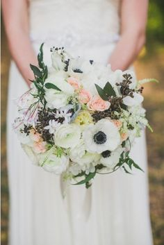 Pretty pastel colors and anemone flowers from Stems Floral Design fill this garden bouquet. Photo by Taylor Lord Photography #weddingbouquet #austinwedding