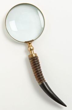 Magnifying glass with horn handle.