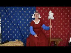 15th Century Spinning shows how to use a sitting distaff - YouTube