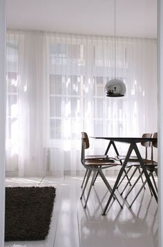 Like the dark wood table on light wood floor. Also like the hanging lamp. Could be nice to pair this with whatever lamp we have hanging in the living room.