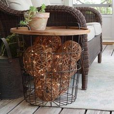 Getting my porch ready for warm weather:sunny: Our screen porch opens up into our main living area so I like it to look pretty and these lighted grapevine  balls make for a super fun lighted side table :two_hearts: i'm telling you how easy this is today o
