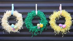 Colored paper shred wreaths with eggs