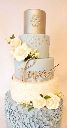 Pale blue gold & embellished ruffle cake
