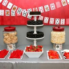 Poker/texas hold'em party? String a deck of cards over the snack buffet. ( cute )