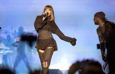 Rihanna Adam Selman corset chap pants and brown sweatshirt at Sziget Festival…