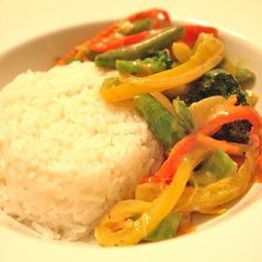 Coconut Curry Vegetables - A delicious coconut curry sauce covers lots of fresh vegetables, protein can also be added. Alongside yummy coconut rice.
