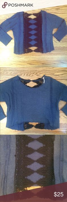 Free People Lace Distressed Sweatshirt You can feel comfy and cute in this high low distressed sweatshirt by Free People. 70% cotton, wide scoop neck line. Distressed details on the hems and stitching. Free People Tops Sweatshirts & Hoodies