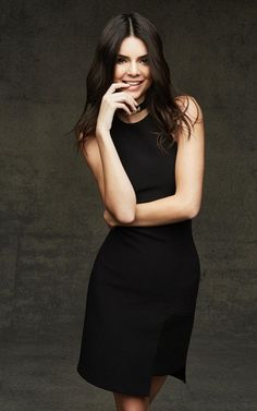 Kendall Jenner wears a black dress with a bold choker for Kendall and Kylie's Topshop Christmas Collection.