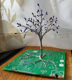 CIRCUITree resistor and circuit board tree sculpture. $48.00, via Etsy.