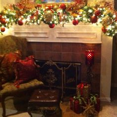 Christmas mantle decor. Love how full the garland is and of course the lights.