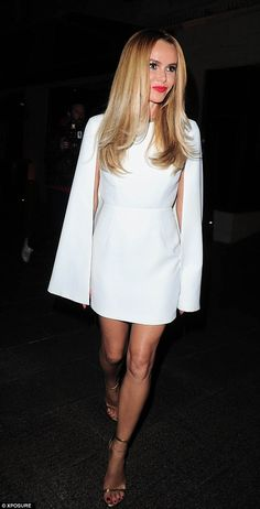 Not so busty now! Amanda Holden cuts a demure figure in white caped mini dress as she hits the Britain's Got Talent wrap party | Daily Mail Online