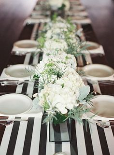 Black and white stripe runner. Use a clear beaded charger or a black matte wooden charger underneath white plate and place white napkin on plate with a black wooden napkin ring. This gives a more finished and elegant look to the table!