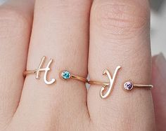 Personalized initial and birthstone ring.