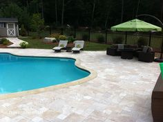 French Pattern Ivory Swirl Tumbled Travertine Pavers  http://www.travertinemart.com/products-page/ivory-swirl/special-until-013113-premium-select-french-pattern-ivory-swirl-travertine-pavers