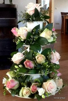 Beautiful Etagere made of china , roses , waxflowers and fresia's This centerpiece is made by Janneke @ 'Art de la fleur'