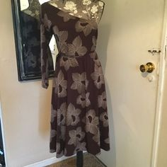 Maggy L 1 Shoulder Dress Like new.. Comes in on one side of waist has string to tie in back.. No buttons or zippers 95% polyester 5% spandex.. Dry clean.. Very pretty brown with white splash designs all over Maggy London Dresses Asymmetrical