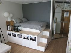 If your bedroom doesn't have a closet (or you abide by the belief that there's no such thing as too much clothing storage) mount your bed on top of IKEA cabinets to provide ample space for sweaters and shirts under your mattress. See more at Oh Yes »