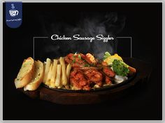 Delicious and wholesome Chicken Sausage cooked with aromatic spices served with vegetables and French fries. Enjoy your Weekend with Chicken Sausage Sizzler at DownTown Cafe.  http://Mydowntown.in/  #DownTown #DownTownCafe #India #Food #Cafe #Beaches #Smoothies #Sizzler #FrenchFries #ChickenSausage