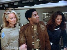 ) and Athena (Maren Jensen) - Battlestar Galactica Fire in Space (First Aired December 17 Old Sci Fi Movies, Maren Jensen, Kampfstern Galactica, Battlestar Galactica 1978, Disaster Film, 70s Tv Shows, Star Wars Poster, Classic Tv, Favorite Tv Shows