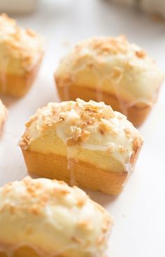 Mini Lemon Coconut Loaf Cakes easy soft fluffy loaf cakes full of lemon flavor and coconut flakes with a glossy tangy glaze Baking Recipes, Cake Recipes, Dessert Recipes, Loaf Recipes, Dutch Recipes, Food Cakes, Cupcake Cakes, Cupcakes, Mini Loaf Cakes
