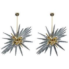 Pair of Brass and Murano Glass Sputnik Chandeliers   From a unique collection of antique and modern chandeliers and pendants at https://www.1stdibs.com/furniture/lighting/chandeliers-pendant-lights/