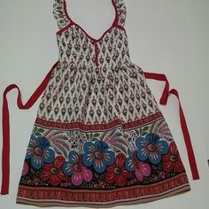 """Boho Boutique Tunic Top - Sz Small Boutique Top by Karlie. Size Small. Boho Print. Side Zipper. Ribbon Back Ties. Red and Off White with Colorful Detail. Cotton Blend. Stretch Smocked Panel at Back. Very Small Burr on Ribbon Tie (picture 4). No stains, holes or other issues noted.  Measurments: 30""""-34"""" underarm to underarm (doubled - flat to stretched) 26""""-30"""" at empire waist (doubled - flat to stretched) 31-1/2"""" total length Karlie Tops Blouses"""