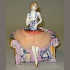 Bonhams 1793 : Schneider powder puff Armchair with half-doll Deco Lady