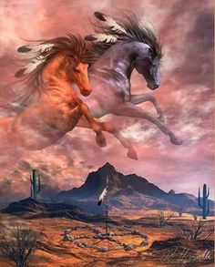 Native American Spirit Horses with feathers in their mane galloping in the sky over open desert land with huge cacti and mountain butte.