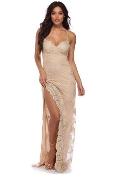 """<p><strong>Special Occasion</strong></p>  <p>Feel like a lost princess in this gorgeous dress! Anastasia features a scallop V neckline, built in cups, thin adjustable straps and a floor length sheath silhouettewith a high slit. She is composed of a lined tulle fabric that features gold floral embroidery throughout. Includes zipper closure.</p>  <p><em>Model is 5'7 with a 34"""" bust, 24"""" waist and ..."""