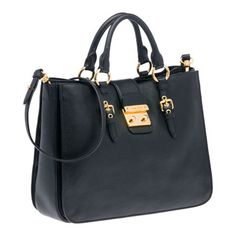 Top Handle By Miu Miu in madras leather. Softy one!