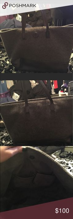 Tory burch wool leather tote bag Gorgeous gray and black Tory burch tote bag!  It is a medium size tote bag but can store a lot!  It is clean inside and outside no damage whatsoever.  Great for autumn and winter!  Gorgeous easy bag to carry! Tory Burch Bags Totes