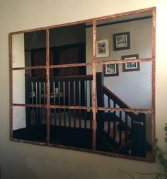 Larger 9 panelled mirror displayed in a hall landing area, opens up a sometimes darker area