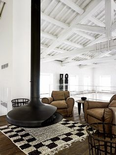 A Renovation in Umbria by Paola Navone. (via A Renovation in Umbria by Paola Navone Suspended Fireplace, Hanging Fireplace, Freestanding Fireplace, Floating Fireplace, Cozy Fireplace, Modern Fireplace, Warehouse Renovation, Loft Industrial, Industrial Design