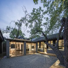 Chinese studio 0 Architecture has converted a traditional courtyard house in Beijing into an office with spaces divided up by screens made… Architect Logo, Architect House, U Shaped Houses, Chinese Courtyard, Chinese Garden, Ancient Chinese Architecture, Chinese Interior, Casa Patio, Famous Architects