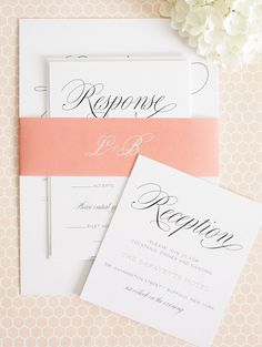 Pretty peach wedding invitations with large script