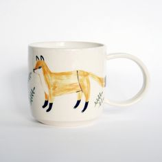 Enjoy your favourite beverage accompanied by foxes. These mugs are just the right size for your morning coffee or afternoon tea. Each of these stoneware pieces features a hand-drawn, glazed exterio...