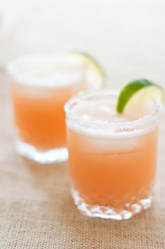 Pink Grapefruit Margaritas  Ingredients:  1/2 lime cut in wedges  Kosher salt  1 cup ruby red grapefruit juice  1/4 cup triple sec  3 freshly squeezed lime juice  2 cups ice  1/2 cup white tequila  Makes 4 drinks