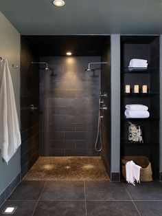 Various Dual Shower Designs: Contemporary Bathroom Basement Double Shower Heads With Pebble Base And Storage Shelves ~ cienmaneras.com Bathroom Inspiration
