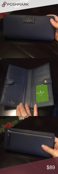 NWT Kate Spade wallet - Diverblue Beautiful Kate spade wallet of genuine leather featuring  18 credit card slots and a back zipped pocket for extra storage space. kate spade Bags Wallets