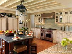 coastal kitchen washed wood cabinets and lantern light