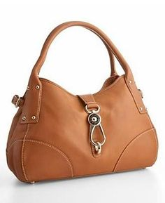 Now this is one Dooney & Bourke I'd carry!!  Leather Bag — Luxist