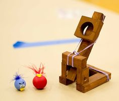 catapult, painted wooden beads and jenga blocks for a mini game of angry birds