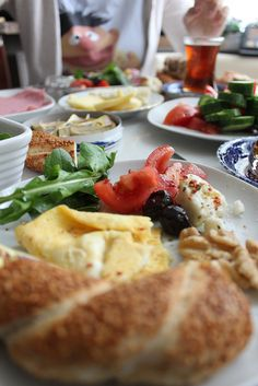 Turkish Breakfast with Ernie :) simit, cheese, tomato, omlette, black olive, walnut, garden rocket and black tea.