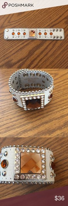 Leather embellished cowgirl bracelet Genuine leather bracelet in white with bling embellished 3 snap adjustable bracelet beautiful. Boutique tagged Jewelry Bracelets