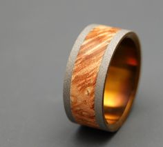 Ring of Fire - Wooden Wedding Rings. $200.00, via Etsy.