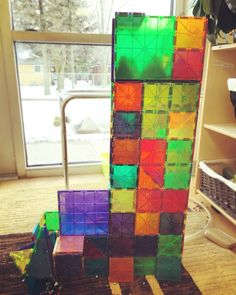 Building with Magna-Tiles... can you see what's inside?