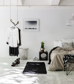 I like the hanging branch supporting the clothes , and the night stand with the circular cut out