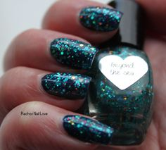 Ellagee Beyond the Sea over Barry M Blackberry. From her You're The Top! Glitter topper collection.