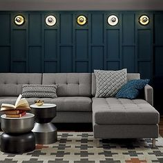 """Style Forecast: Sofa Trends for 2014 & Beyond Apartment Therapy """"Grey: Still going strong for practical purposes, but now with a twist such as colored buttons or a unique retro shape"""""""
