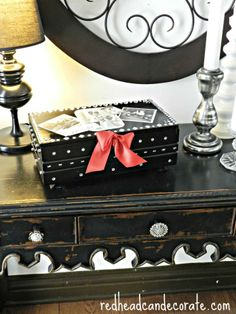 Create a special place for treasured family photos & memories. Try revamping an old wood box with @Rust-Oleum U.S. Painters Touch Gloss Black Paint!